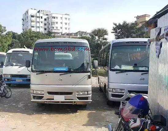 Get Monthly Ac Mini Bus Rental for Office Transport in Segunbagicha